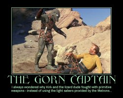 The Gorn Captain --- I always wondered why Kirk and the lizard dude fought with primitive weapons - instead of using the light sabers provided by the Metrons...