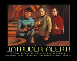 Intruder Alert! --- If we all fire our phasers simultaneously, perhaps that will deter this hideous alien voyeur...